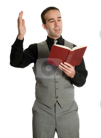 Actor Reading His Script stock photo, A young actor dressed in an older suit is reading his movie script, isolated against a white background by Richard Nelson