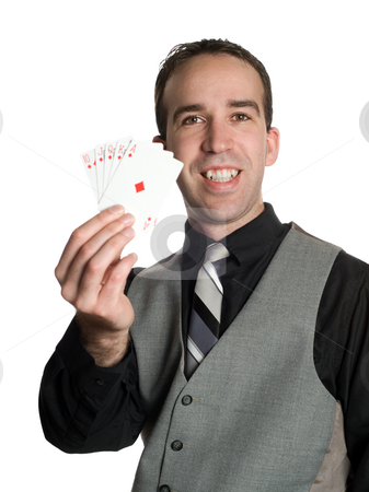 Winning Hand stock photo, Concept image of a successful businessman holding the winning hand with a royal flush by Richard Nelson