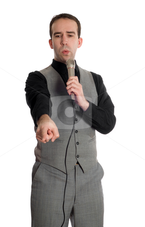 Male Speaker stock photo, A young man wearing a grey suit is making a speech into the microphone, isolated against a white background by Richard Nelson