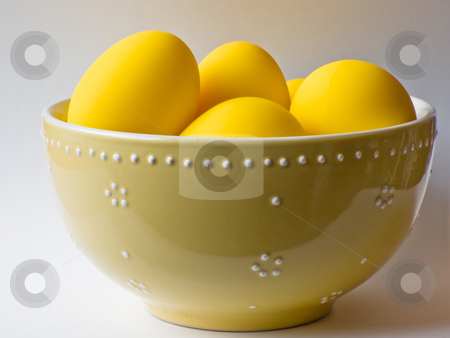 Easter yellow eggs in a bowl stock photo, Fake yellow eggs in a bowl isolated on a white background. by FEL Yannick