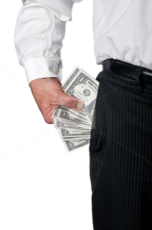 A business executive with a pocket full of cash stock photo, A vertical view of a business exective in pin striped pants with a pocket full of American cash1 by Vince Clements