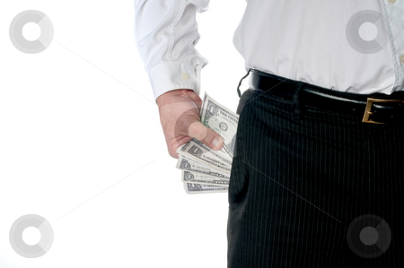 A business executive with a pocket full of cash stock photo, A business executive in pin striped pants with a pocket full of American cash by Vince Clements