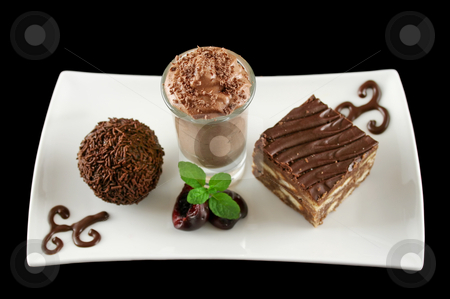 Triple Treat stock photo, Triple chocolate treat of a rum ball and chocolate mousse and slice. by Brett Mulcahy