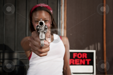 Woman with Gun stock photo, African American woman with a gun on her front porch by Scott Griessel