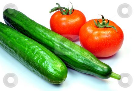Tomatoes and cucumbers stock photo, Fresh vegetables, tomatoes and cucumbers by Fernando Barozza