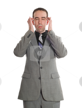Emotional Freedom Technique stock photo, Front view of a businessman tapping the sides of his eyes as a step in performing the Emotional Freedom Technique, isolated against a white background by Richard Nelson