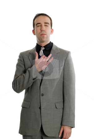 Emotional Freedom Technique stock photo, Front view of a businessman tapping his collar bone as a step in performing the Emotional Freedom Technique, isolated against a white background by Richard Nelson