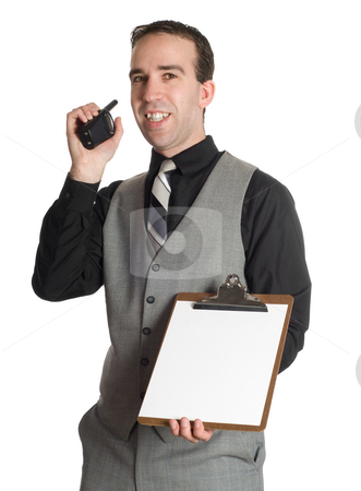 Sign Here stock photo, A young man wearing a suit is smiling while he hands over a clipboard with blank paper on it, isolated against a white background by Richard Nelson