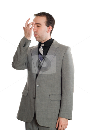 Emotional Freedom Technique stock photo, A young businessman tapping his brow as one of steps in performing EFT, isolated against a white background by Richard Nelson