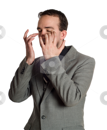 Emotional Freedom Technique stock photo, Closeup view of a businessman tapping under his eyes as a step in performing the Emotional Freedom Technique, isolated against a white background by Richard Nelson