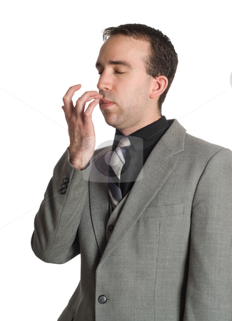 Emotional Freedom Technique stock photo, Closeup view of a businessman tapping under his nose as a step in performing the Emotional Freedom Technique, isolated against a white background by Richard Nelson