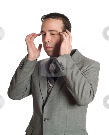 Emotional Freedom Technique stock photo, Closeup view of a businessman tapping the sides of his eyes as a step in performing the Emotional Freedom Technique, isolated against a white background by Richard Nelson