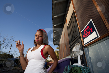 African-American woman in front of house stock photo, African-American woman in front of rental house by Scott Griessel