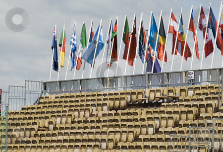 Stadium stock photo, Rows of seats in a temporary stadium with flags of various nations by Stephen Gibson