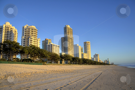 Surfers Paradise Skyline stock photo, Surfers Paradise beach, Gold Coast Australia in the early morning golden light. by Brett Mulcahy