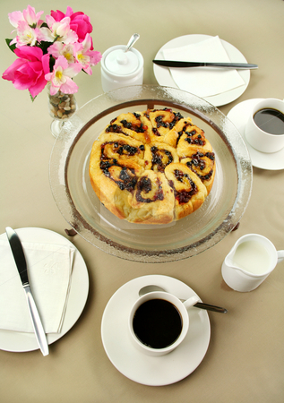 Chelsea Bun And Coffee stock photo, Delicious fresh baked chelsea bun with black coffee ready to serve. by Brett Mulcahy