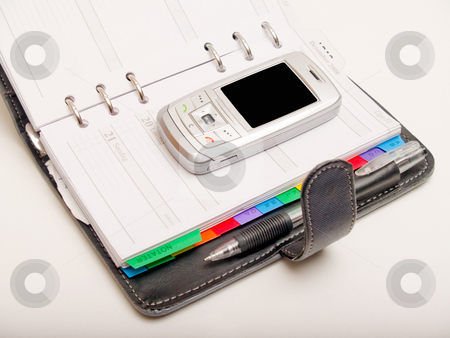Business  objects - Pen diary and a cell phone stock photo, Business  objects - Pen  diary and a cell phone by Phillip Dyhr Hobbs