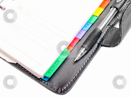 Office objects - Pen,  diary and a cell phone on white  stock photo, Office objects - Pen,  diary and a cell phone on white background by Phillip Dyhr Hobbs