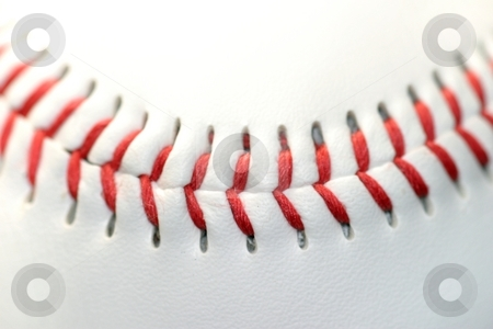Baseball stock photo, Close up of a white baseball with red seams by Henrik Lehnerer
