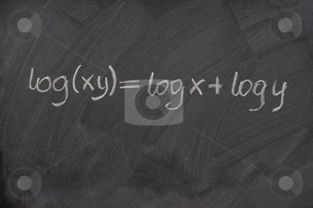 Logarithm formula on a school blackboard stock photo, Logarithm formula (reduction of multiplication to addtion) handwritten with white chalk on a school blackboard with eraser smudges and pattern by Marek Uliasz