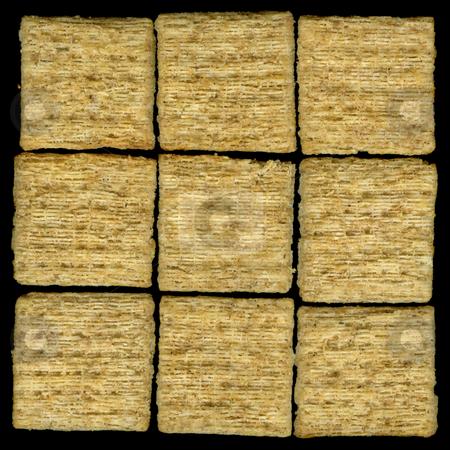 Baked whole wheat crackers stock photo, Nine baked whole wheat crackers with rosemary isolated on black by Marek Uliasz