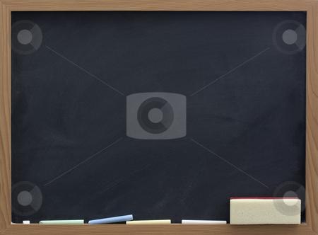 Blank blackboard with eraser and chalk stock photo, Blank blackboard with eraser and chalk, smudge patterns,  white dust by Marek Uliasz