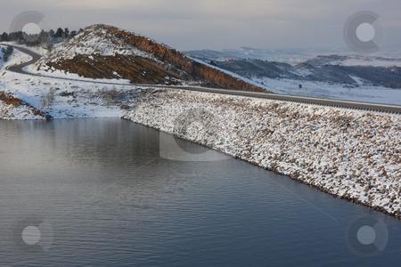 Mountain reservoir, dam and windy road stock photo, Mountain lake, rock cliff, dam and windy road - Horsetooth Reservoir near Fort Collins, Colorado in winter scenery by Marek Uliasz