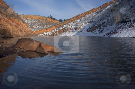 Mountain lake with sandstone cliffs and snow stock photo, Mountain lake in Colorado  (Horestooth Reservoir near Fort Collins) in early spring with red sandstone cliffs and snow by Marek Uliasz