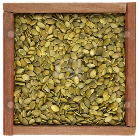 Pepitas (pumpkin seeds) in a wooden box stock photo, Pepitas (pumpkin seeds) in a wooden box or frame isolated on white background by Marek Uliasz