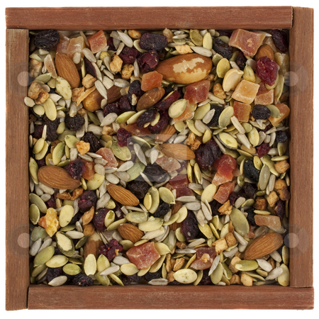 Trail mix with nuts, berries and seeds in a wooden box stock photo, Trail mix with pumpkin, sunflowers seeds, almonds, dried papaya,  cranberries, raisins, apples, Brazilian nuts in a rustic wooden box or frame  isolated on white by Marek Uliasz