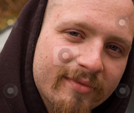 Closeup of Young Caucasian Male stock photo, Closeup of a young Caucasian male mid 20's, hazel eyes, smiling and a raggy goatee. by Valerie Garner