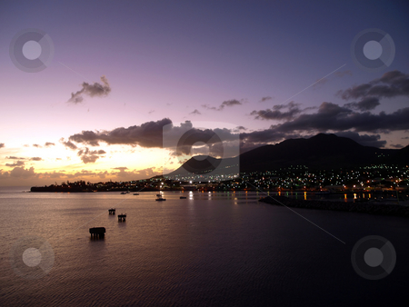Sunset over St. Kitts stock photo, View of St. Kitts under a cloudy sunset sky by Jill Reid
