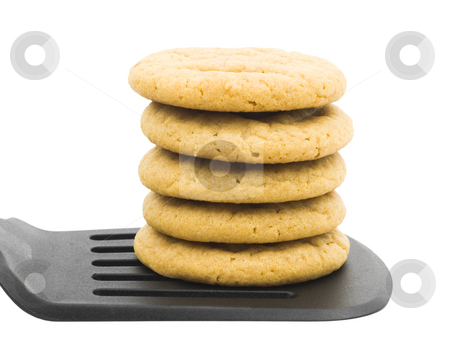 Peanut butter cookies stock photo, Peanut butter cookies stacked on a spatula by John Teeter