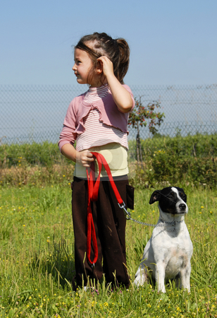 Little girl and dog stock photo, Little girl and her purebred jack russel terrier by Bonzami Emmanuelle