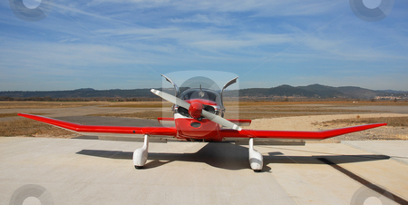 Little airplane stock photo, Private red plane Robin DR 250 on an airport in the south in France by Bonzami Emmanuelle