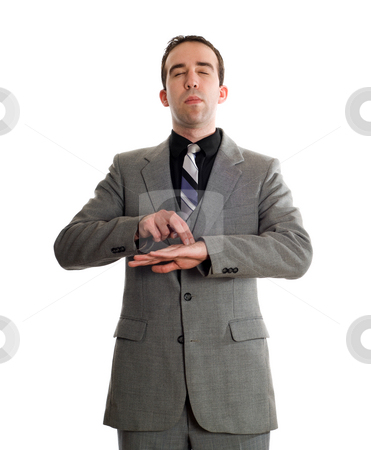 Emotional Freedom Technique stock photo, Front view of a businessman tapping a point on his hand as a step in performing the Emotional Freedom Technique, isolated against a white background by Richard Nelson