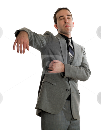 Emotional Freedom Tapping stock photo, Front view of a businessman tapping under his arm as a step in performing the Emotional Freedom Technique, isolated against a white background by Richard Nelson