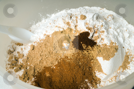 Baking Mixture stock photo, A mixture of ingredients about to be sifted together in a mixing bowl by Richard Nelson