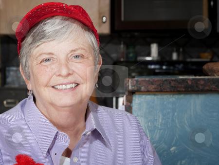 Senior Woman Wearing Red Hat stock photo, Friendly senior woman wearing a red hat by Scott Griessel