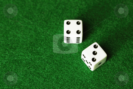 Dice on green background stock photo, Dice on green background by Bryan Mullennix
