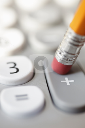 Pencil pushing addition button on calculator stock photo, Pencil pushing addition button on calculator by Bryan Mullennix