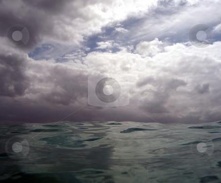 Dramatic cloudy sky over calm ocean stock photo, Dramatic cloudy skies over a seemingly calm ocean by Jill Reid