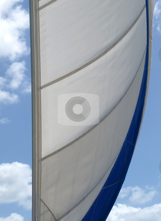 Wind in the sail against a cloudy blue sky stock photo, Full mainsail against a cloudy bright blue sky by Jill Reid