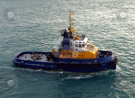 A pilot boat ready to assist stock photo, A blue and yellow pilot boat stands ready to lead and assist by Jill Reid