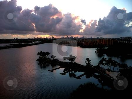 Miami skyline at snset stock photo, Sunset with Miami skyline at horizon, with water reflecting in the bay by Jill Reid