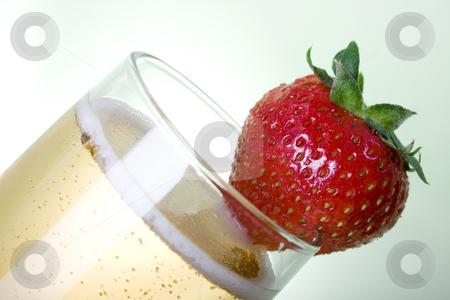 Champagne with Strawberry sideways stock photo, Champagne with Strawberry over light green background by iodrakon