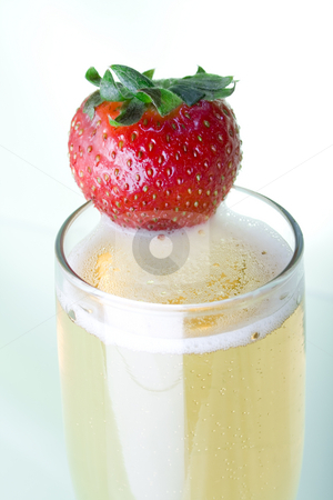 Champagne with Strawberry stock photo, Champagne with Strawberry over light green background by iodrakon