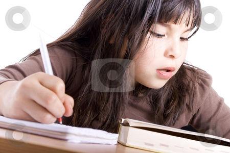 Girl studying stock photo, Young Girl doing homework - Isolated on white by iodrakon