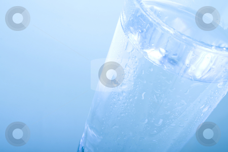 Glass of Water stock photo, Glass of water on Blue Background by iodrakon