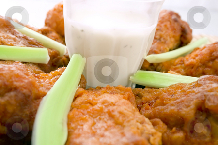 Hot Chicken Wings stock photo, Clouse-up of Hot Chicken Wings with celery and dip - Selective focus on center by iodrakon